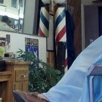 Photo taken at Del's Barber Shop by Tim C. on 9/10/2011