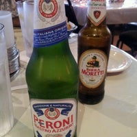 Photo taken at Reale's Pizza & Cafe by marii t. on 8/11/2012