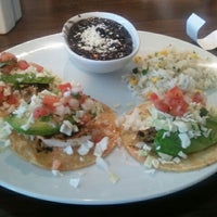 Photo taken at Blanco Tacos + Tequila by Alli F. on 7/9/2012
