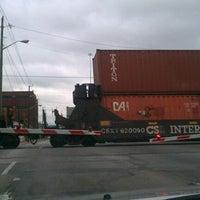 Photo taken at Michigan Street Railroad Crossing by Kev M. on 9/30/2011