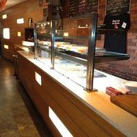 Photo taken at Krunch Pizza Bar by Wilfredo T. on 6/29/2012