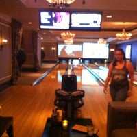 Photo taken at High Rollers Luxury Lanes & Lounge by Dan N. on 10/22/2011