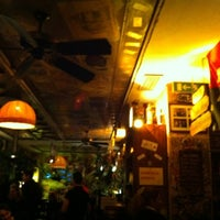 Photo taken at La Bodeguita del Medio by Henrique T. on 2/16/2012