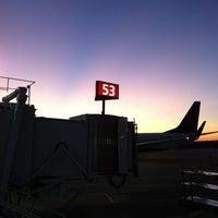 Photo taken at Gate C55 by Bryan M. on 10/24/2011