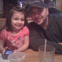 Photo taken at Applebee's Neighborhood Grill & Bar by Carly G. on 12/27/2010