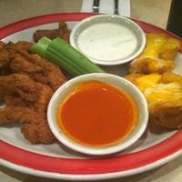 Photo taken at Ninety Nine Restaurant by K W. on 8/20/2011