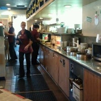 Photo taken at Millie's Restaurant & Bakery by Mae W. on 12/26/2011
