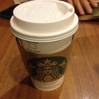 Photo taken at Starbucks by Iman S. on 4/12/2012