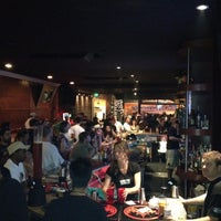 Photo taken at Republic Bar & Grill by Ernesto Torres @. on 4/22/2012