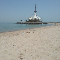 Photo taken at Marina Beach by Mishaal A. on 7/17/2012