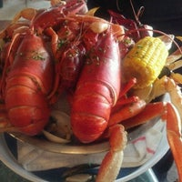 Photo taken at Poppy's Crazy Lobster Bar & Grill by Cherry Kay A. on 5/18/2012