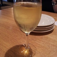 Photo taken at California Pizza Kitchen by Adrienne B. on 8/7/2012