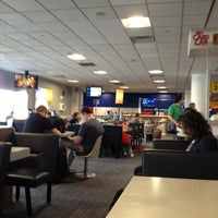 Photo taken at Gate D5 by Derrick J. on 5/25/2012