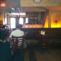 Photo taken at Tapeo Restaurant and Tapas Bar by Richard on 6/15/2012