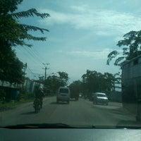 Photo taken at Jalan Medan-Binjai by Fandika K. on 7/25/2012