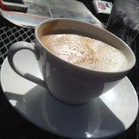 Photo taken at Buchi Cafe Cubano by Karen G. on 6/2/2012