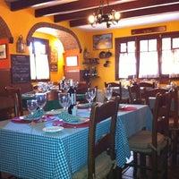Photo taken at Cocina de La Abuela by Olivia T. on 2/16/2012