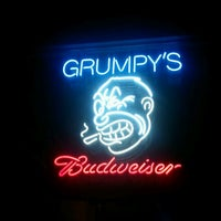 Photo taken at Grumpy's Bar & Grill by Karina T. on 10/11/2011