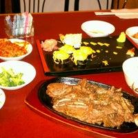 Photo taken at Midori Japanese Restaurant by Benjamin W. on 9/2/2012