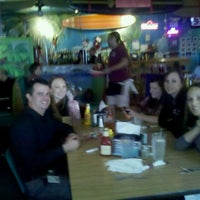 Photo taken at Cabo's Island Grill & Bar by Robin Y. on 12/13/2011