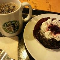 Photo taken at Starbucks by Miho K. on 11/15/2011