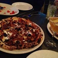 Photo taken at Tutta Bella Neapolitan Pizzeria by Monica R. on 9/8/2012