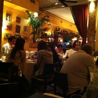 Photo taken at Trattoria Dopo Teatro by Hande on 8/1/2012