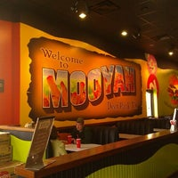Photo taken at MOOYAH Burgers, Fries & Shakes by Ruben D. on 1/12/2012