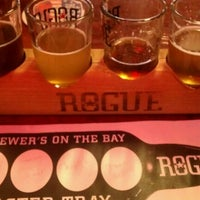 Photo taken at Rogue Ales Brewer's on the Bay by Katie M. on 12/29/2011