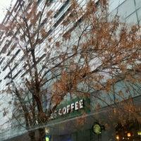Photo taken at Starbucks by Florin G. on 12/6/2011