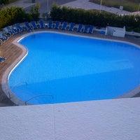 Photo taken at Hotel Meia Lua by Tiago I. on 8/4/2012