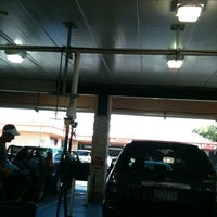 Photo taken at Mister Car Wash & Express Lube by Gus S. on 10/30/2011