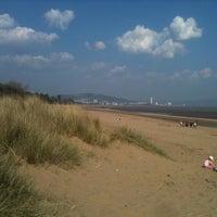 Photo taken at Swansea Bay Beach by Philip J. on 4/21/2011