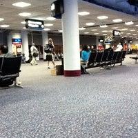 Photo taken at Gate E34 by Jordyn G. on 10/4/2011