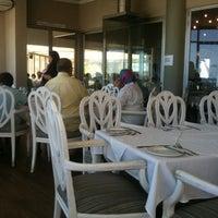 Photo taken at Blowfish Restaurant by Janine B. on 1/3/2011