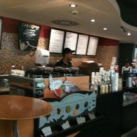 Photo taken at Starbucks by Alfredo C. on 1/8/2011