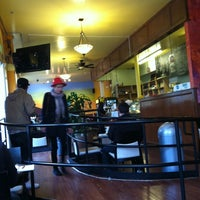 Photo taken at Oasis Cafe by Rosemarie M. on 3/27/2012