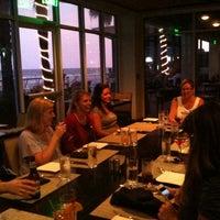 Photo taken at BLU Restaurant & Bar by Janice P. on 8/4/2011