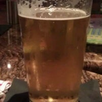 Photo taken at BJ's Restaurant and Brewhouse by Winnie N. on 12/25/2011