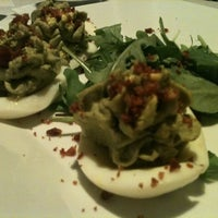 Photo taken at Osteria 1909 by Joy D. on 12/30/2011