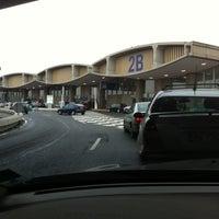 Photo taken at Terminal 2B by Elwyne S. on 12/23/2011