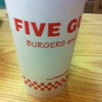 Photo taken at Five Guys by Ben G. on 3/23/2012