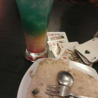 Photo taken at Luget resto cafe by Arrya A. on 5/12/2012