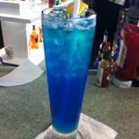 Photo taken at Islander Bar & Grill by Coco M. on 10/20/2011