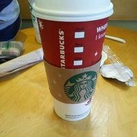 Photo taken at Starbucks by Stanley P. on 12/1/2011