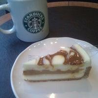 Photo taken at Starbucks by Lupe C. on 1/18/2012