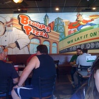 Photo taken at Beggars Pizza by Ruby M. on 7/14/2011