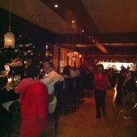 Photo taken at Mango Shiva Indian Bistro & Chai Bar by Monty G. on 2/15/2011
