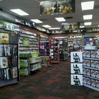 Photo taken at GameStop by Jocelyn E. on 9/4/2011
