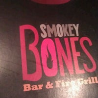 Photo taken at Smokey Bones Bar & Fire Grill by Vivian G. on 4/15/2012